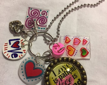 Amy Labbe pendant with shrinky dink charms and vintage buttons