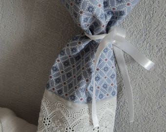 Small linen pouch and broderie anglaise