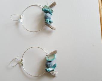 hoop earrings with silver metal beads shells and tassels