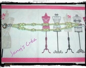 Bracelet double row light green pearls