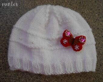 White crochet wool baby hat with red felt Butterfly