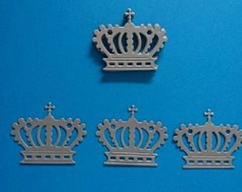 10 Crowns in silver paper cutouts
