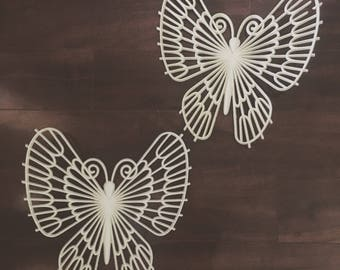 Two butterfly wall hangings.