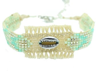 Fringe and silver cowrie blue woven bracelet