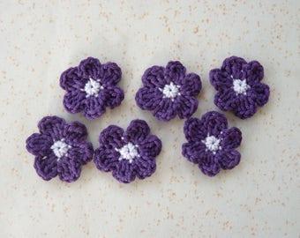 6 small purple crochet flowers