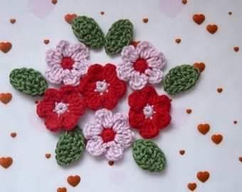 6 red and pink flowers and 6 green leaves crochet