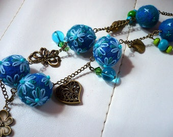 necklace made of beads, wool felted and embroidered blue and green