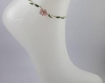 Bracelet de cheville élément fleural.
