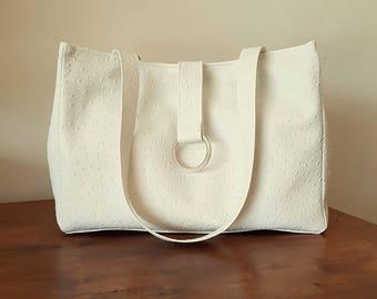 White faux leather print ostrich skin handbag