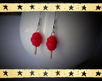 cotton covered with cherry red candy of powder of velvet on dangling earrings