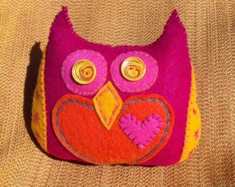 magenta, orange, yellow, and pink plush owl