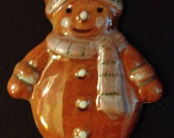 Snowman decoration to suspend in porcelain