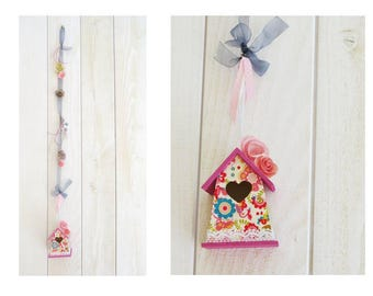 One decorative birdhouse in pink and grey