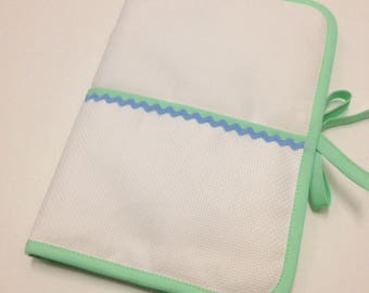 Health book has embroidery cross stitch, white fabric, aida fabric choice