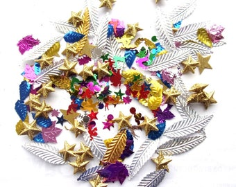 items - more than 200 pieces - confetti leaves angels, stars, etc...