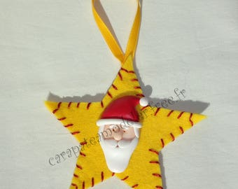 Decoration of Santa Claus on yellow star Christmas tree