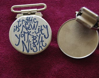 set of 2 clips attached straps, with inscription original English.