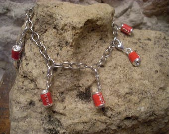 Bracelet with five small cola cans