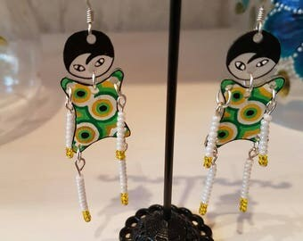 Shrink plastic Earrings: little puppets green yellow and blue.