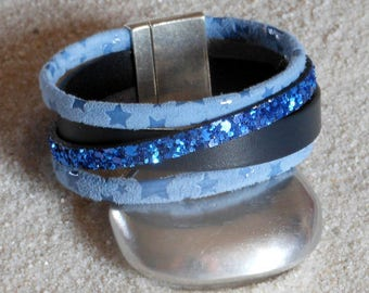 Blue tones with a cross over strap leather Cuff Bracelet. Silver Clasp