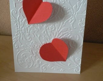 White Valentine's Day card and 2 Red