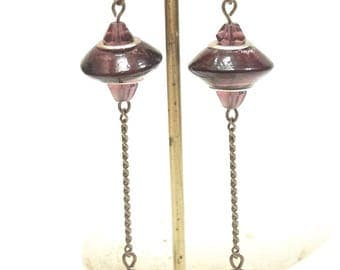 Long earrings made of plum and bronze color