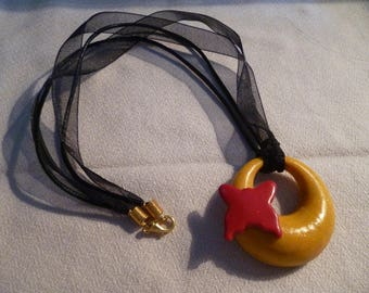 Pretty necklace with polymer clay pendant.