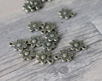 set of 10 charms bronze brass little flower 1 3x1cm