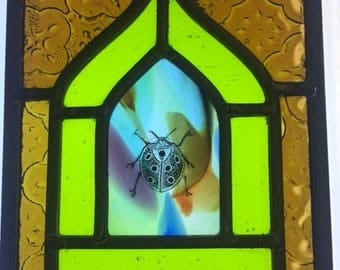 Mini stained glass window with hand painted lady bird detail.