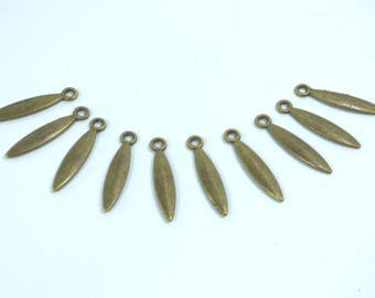 10 charms elongated metal bronze