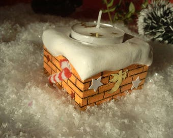 Top fireplace snowy wooden candle holder