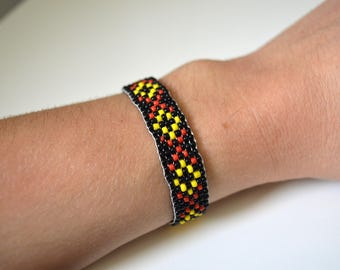Black, yellow and Red pearl bracelet