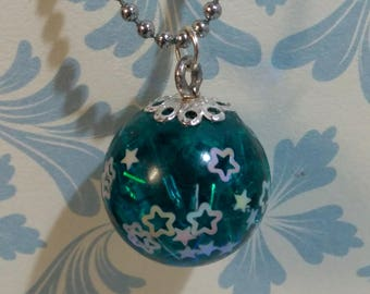 Teal and stars resin ball pendant necklace.