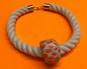 One bead necklace on white rope