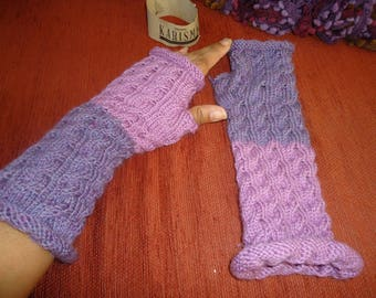 Twisted reverse mittens knitted hands lilac and dusty rose