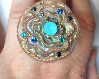 Sheer iridescent button and rhinestone ring