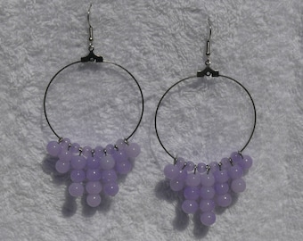 single earring with creole and purple beads