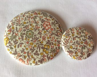 Pocket mirror and Liberty Katie and Millie badge