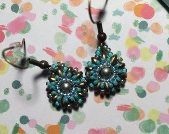 Earrings flowers reflection in water