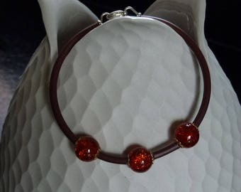 beaded bracelet with orange Crackle glass mounted on buna cord Brown covered memory wire