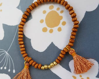 Stretch bracelets several colors available - wooden beads and tassels - handmade