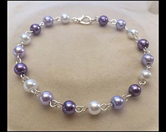 Purple shades glass beads bracelet.