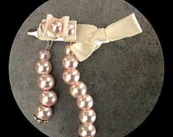 Satin ribbon brooch and glass beads
