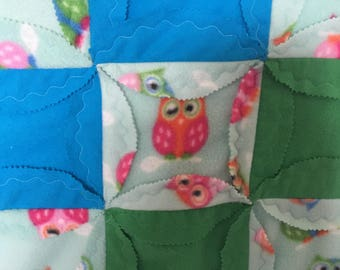 Cozy fleece baby throw, lightweight blanket in colorful circles will keep baby warm.  baby quilt