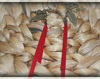 Pair of red feather earrings