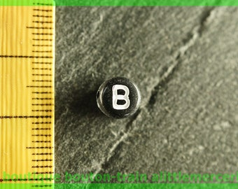 bead b plastic round alphabet white and black