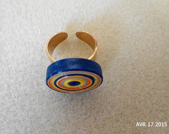 Cylindrical ring in yellow, orange and blue quilling