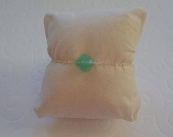 Green clover on each silver chain bracelet