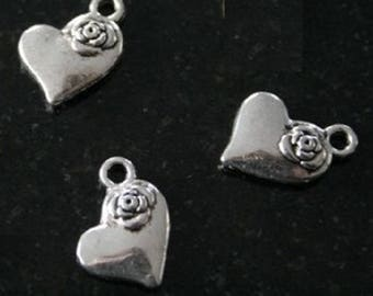 20 heart charms with a rose
