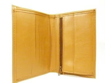 Compact wallet arranged in tall, gold leather